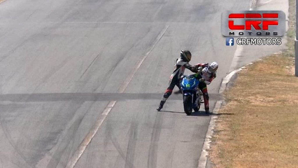 Riders fight during motorbike race