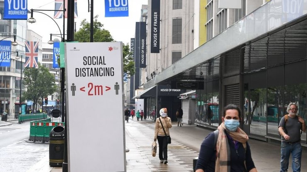 Social distancing sign in London's Oxford Street