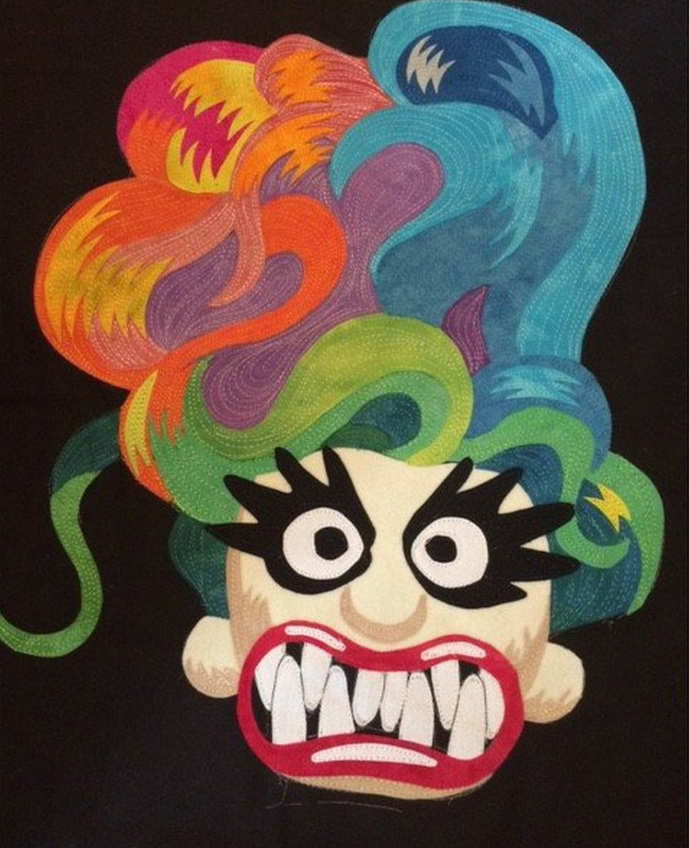 A quilt made by the artist Frank Palmer which depicts as nightmarish version of a popular kids toy, a troll.