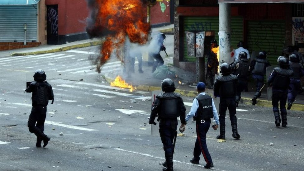 Opposition supporters clash with police during protests against unpopular leftist President Nicolas Maduro in San Cristobal, Venezuela April 19, 2017