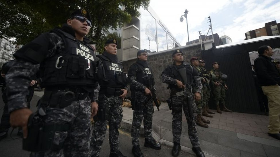 "Security forces stand guard outside the National Electoral Council building in Quito on February 20, 2017, where supporters of Ecuadorean presidential candidate for the CREO party Guillermo Lasso, protest as they wait for the final results of Sunday""s presidential election."