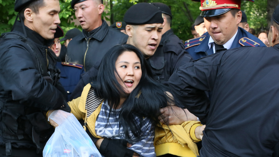 Protester detained on May Day in Almaty, Kazakhstan, 2019