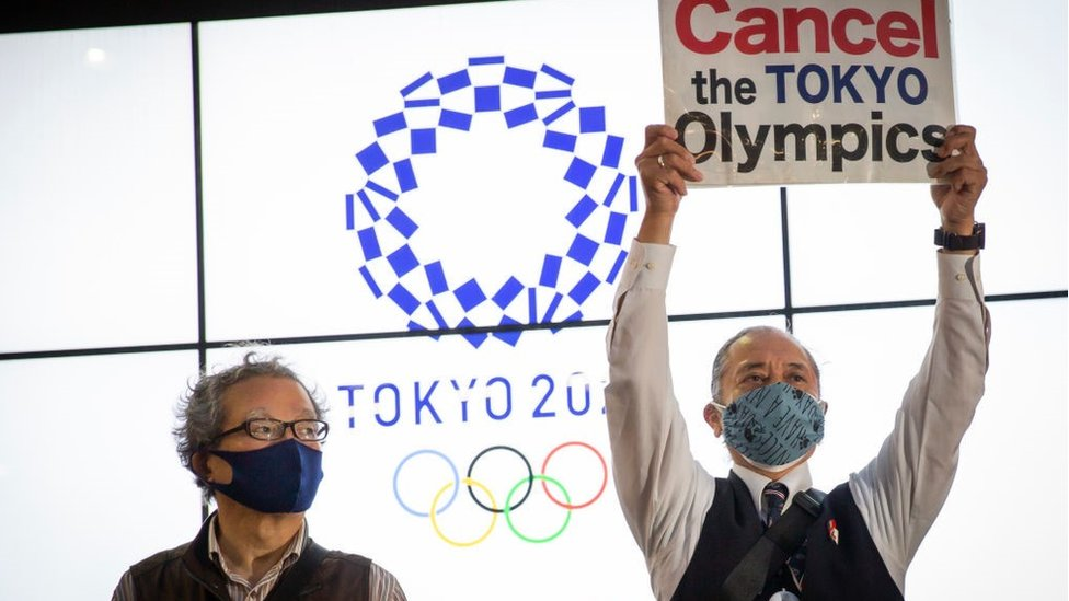 A protester holds a placard during a protest against the Tokyo Olympics on May 17, 2021 in Tokyo, Japan