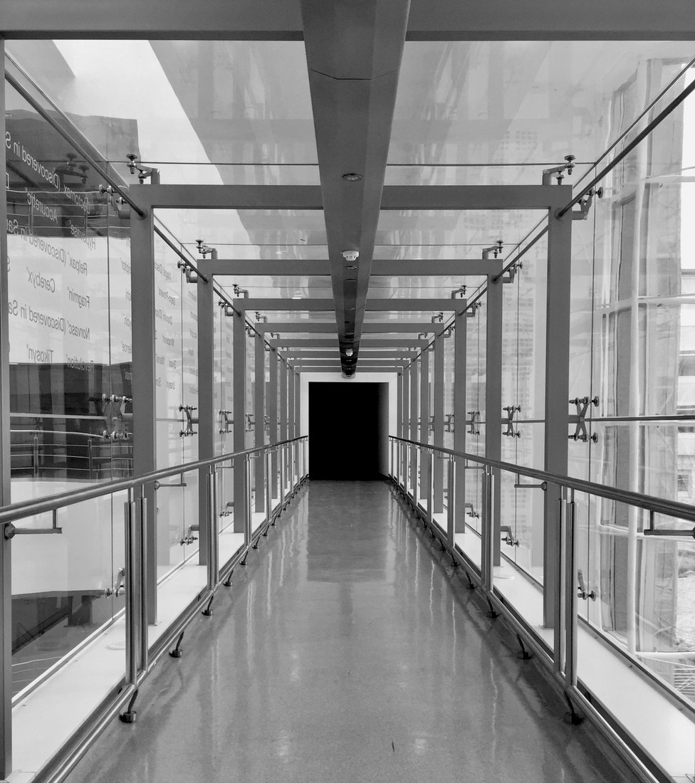 Black and white photograph of a corridor