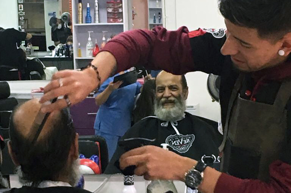 Natalia's uncle, Edgar, having his hair cut after getting his new teeth