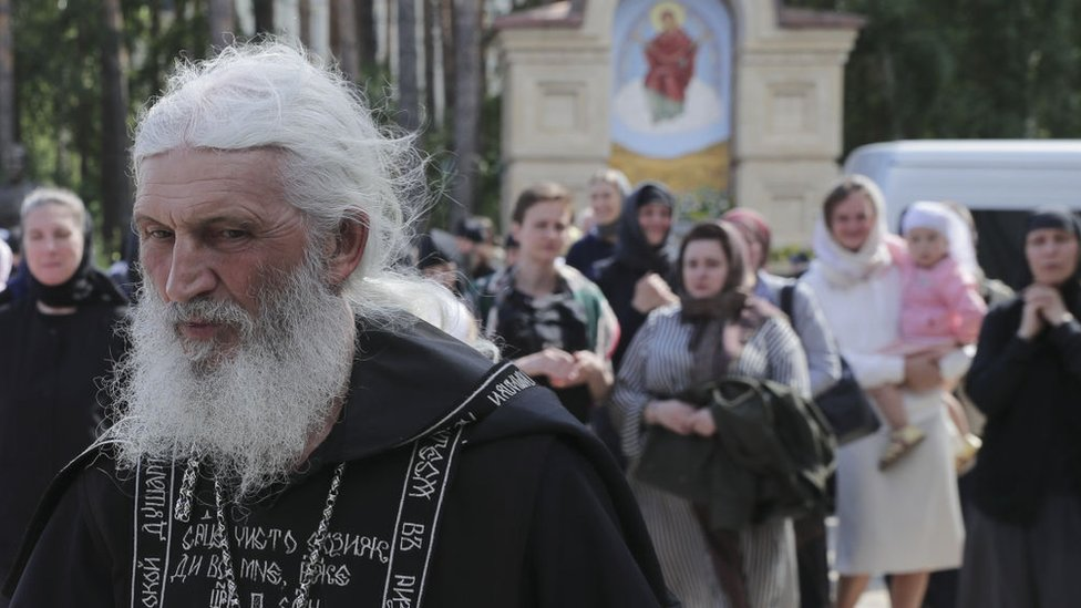 Russia police arrest Covid-denying priest Father Sergiy thumbnail