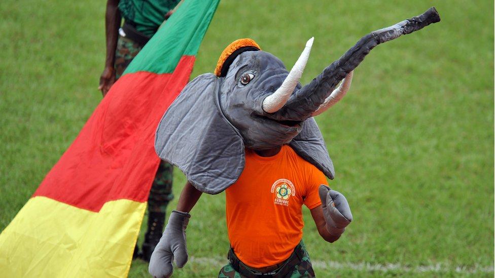 A boy dances dressed as an elephant