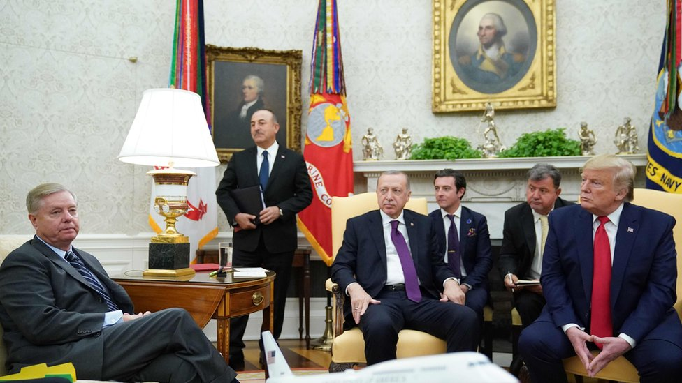 Sen. Lindsey Graham (L) listens as US President Donald Trump and Turkey's President Recep Tayyip Erdogan take part in a meeting in the Oval Office of the White House in Washington, DC on November 13, 2019