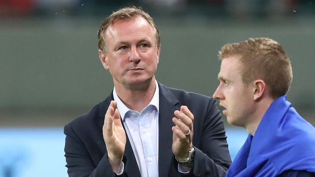 Michael O'Neill applauds his team's performance at the end of the game in Slovakia