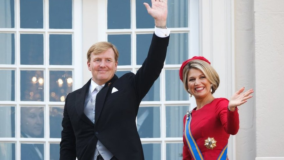 King Willem-Alexander and Queen Maxima wave from the palace balcony in The Hague