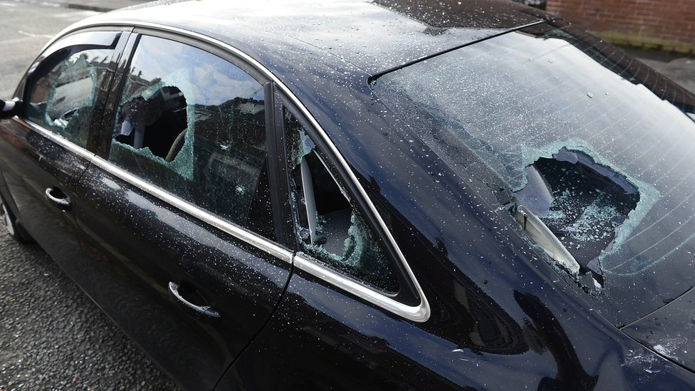 Damage to the car that was parked outside the house at Etna Drive