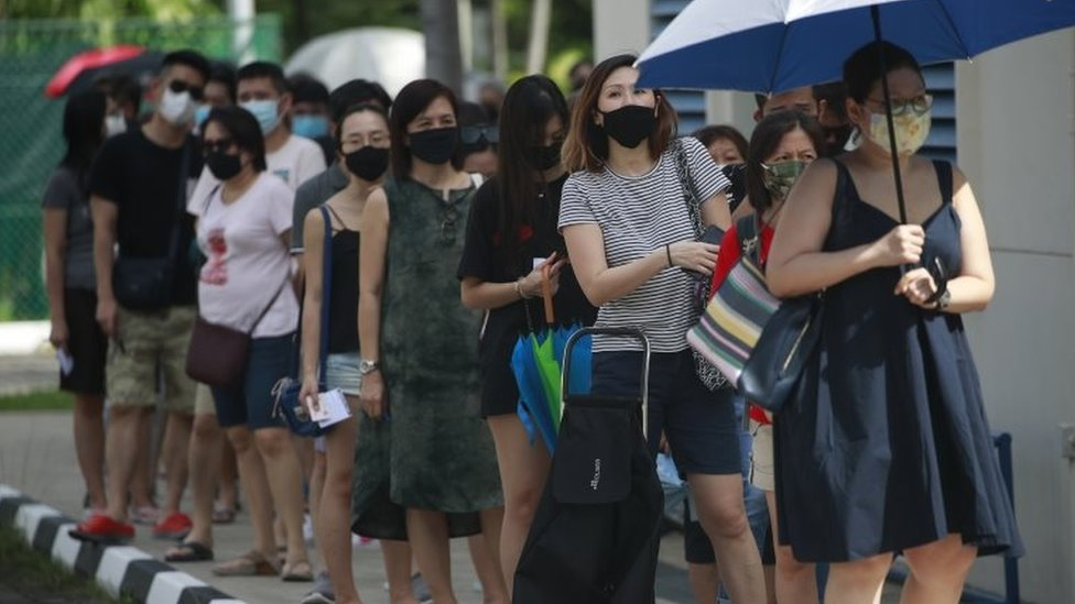 People queue to vote in Singapore (10 July)