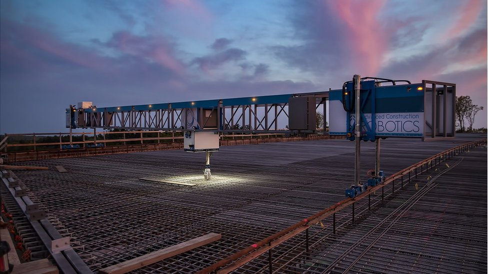 TyBot starting construction at night on a bridge