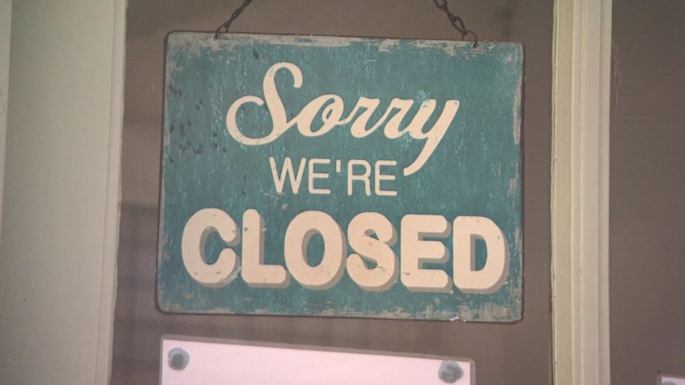 Closed sign on business