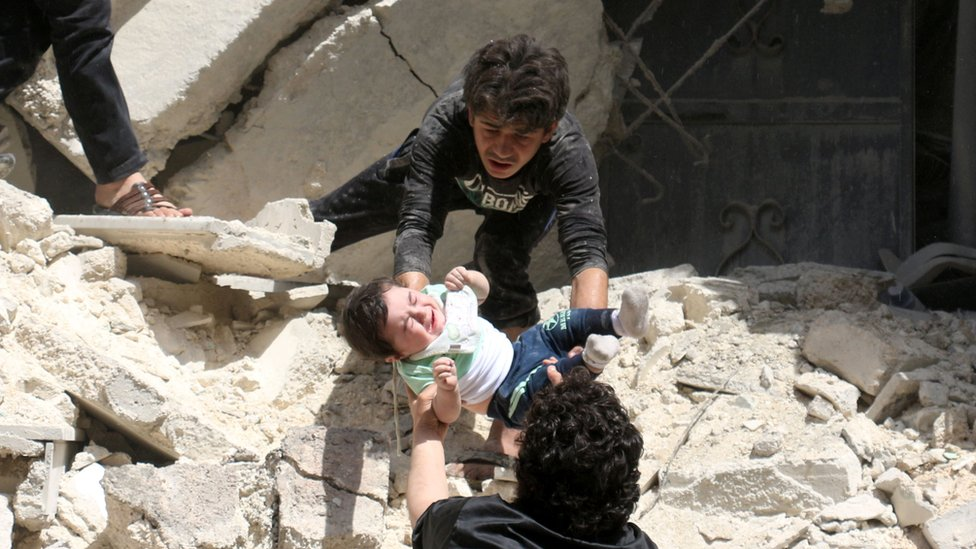 Baby passed out from rubble of destroyed building in Aleppo. 28 April 2016