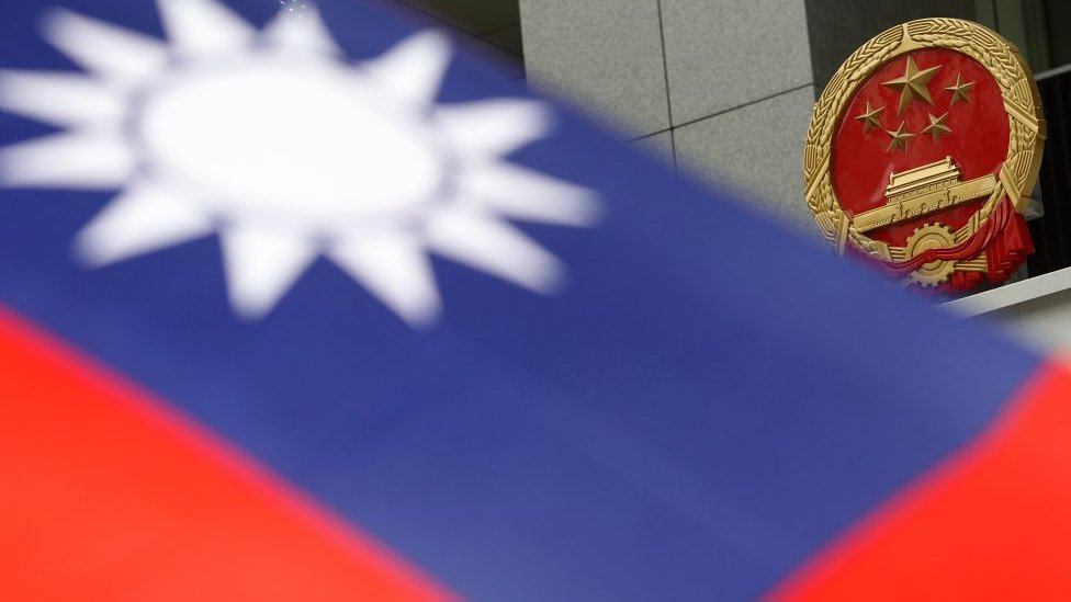 A Taiwan flag being displayed by a protester at the plaza in the new Central Government Office in Admiralty while protesters protest against the government appointed Secretary for Consitutional and Mailand Affairs Stephen Lam Sui-lung as the Chief Secretary. 09OCT11