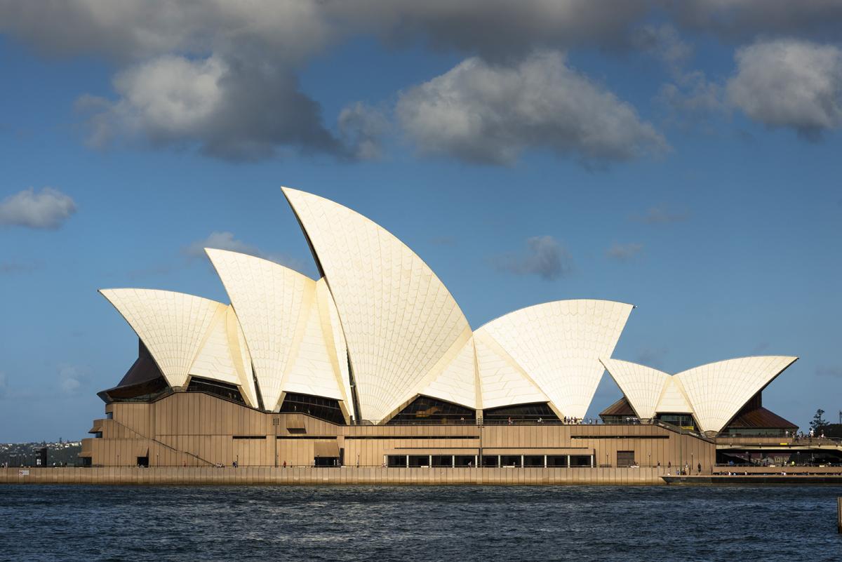 Joe Bertony with a model of the Sydney Opera House arch
