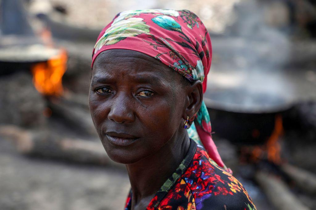 Ladi Kodi sits beside her black soap business in Nigeria