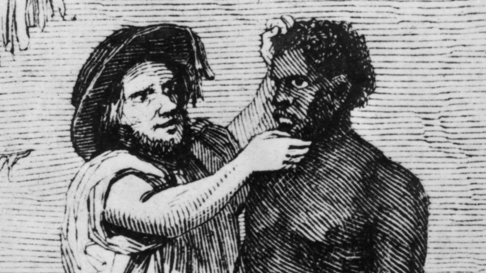 White traders inspect African slaves during a sale, circa 1850
