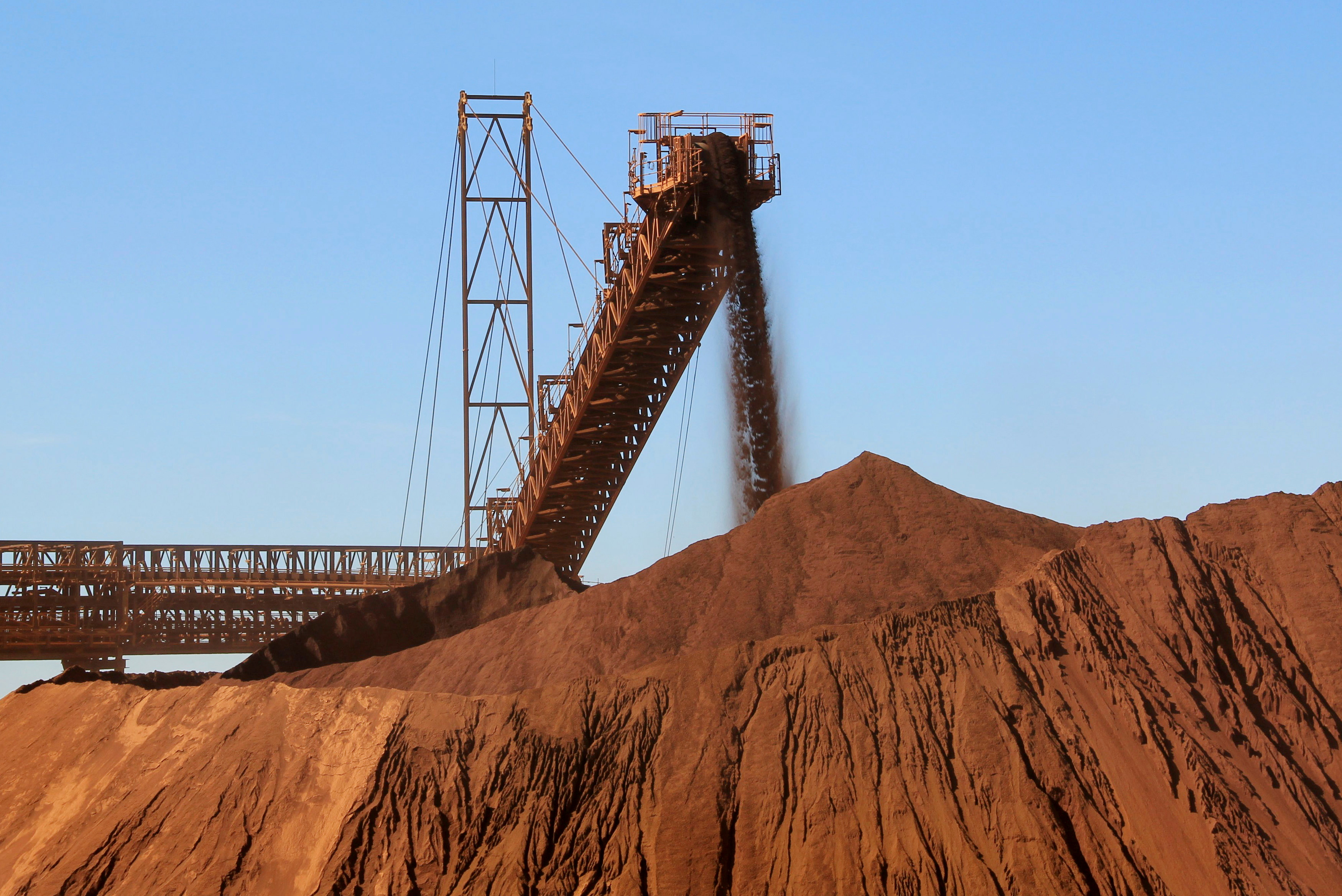 iron ore is loaded into a pile at Fortescue Metals  mine
