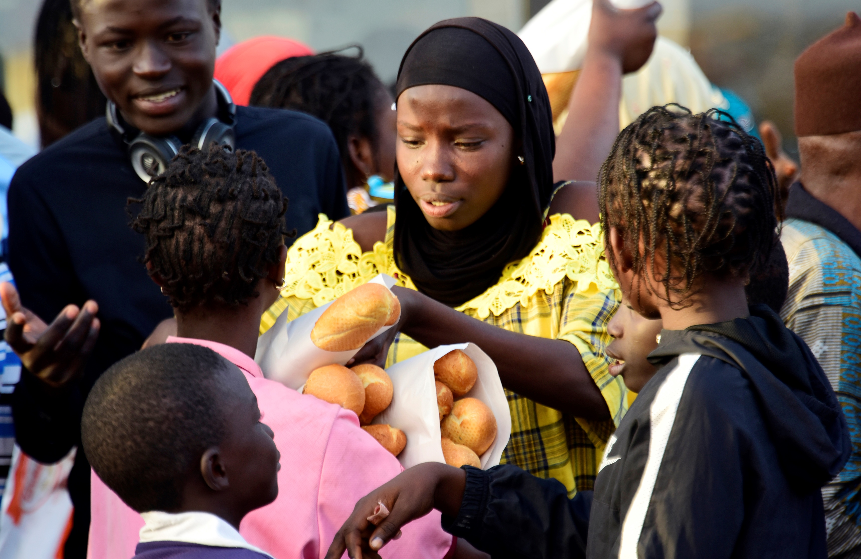 A woman with baguettes in Senegal