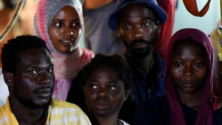 Stranded migrants disembark on Italian island