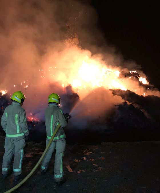 One hundred tonnes of hay alight